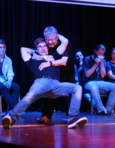 Tom Hadley supports his team mate in last year's Playmates, on the Wollongong Comedy team.